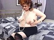 Busty pregnant mom shows her paunch