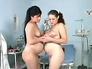 Preggy lesbians have fun with dildo