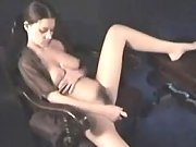 Pregnant brunette plays with pussy